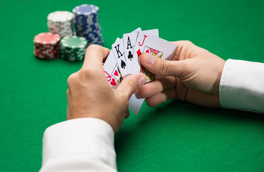 Poker player with cards and gambling chips