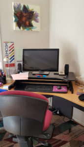 Wynston sit stand desk in seated position